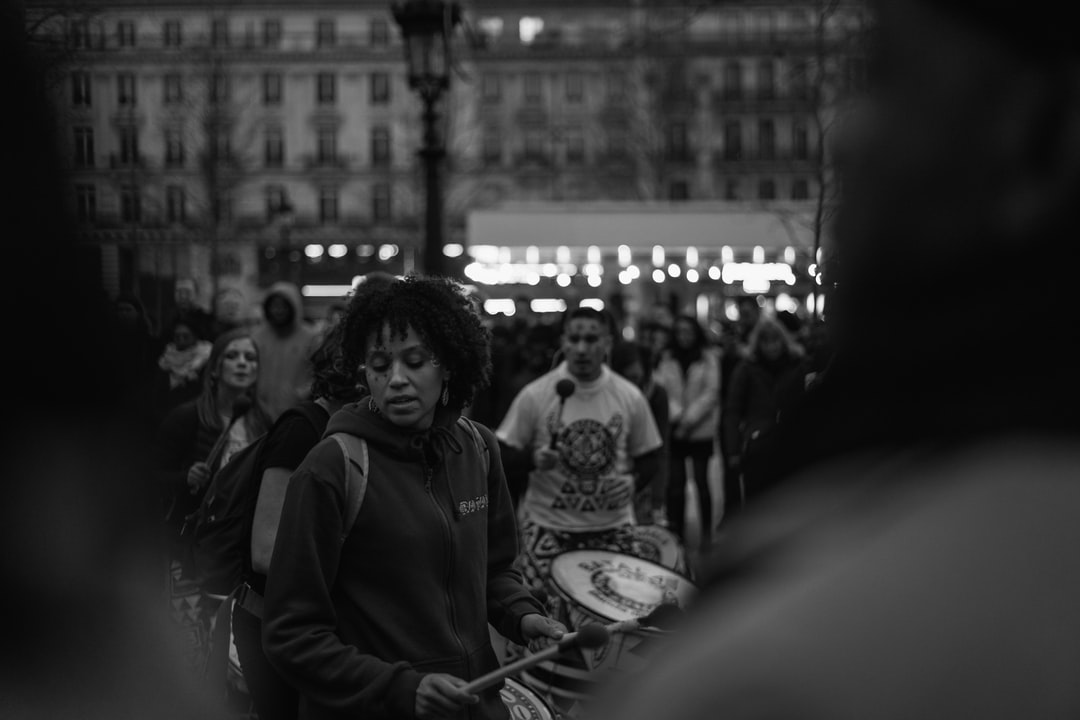 A woman playing drums during the Carnival in Paris 🇫🇷