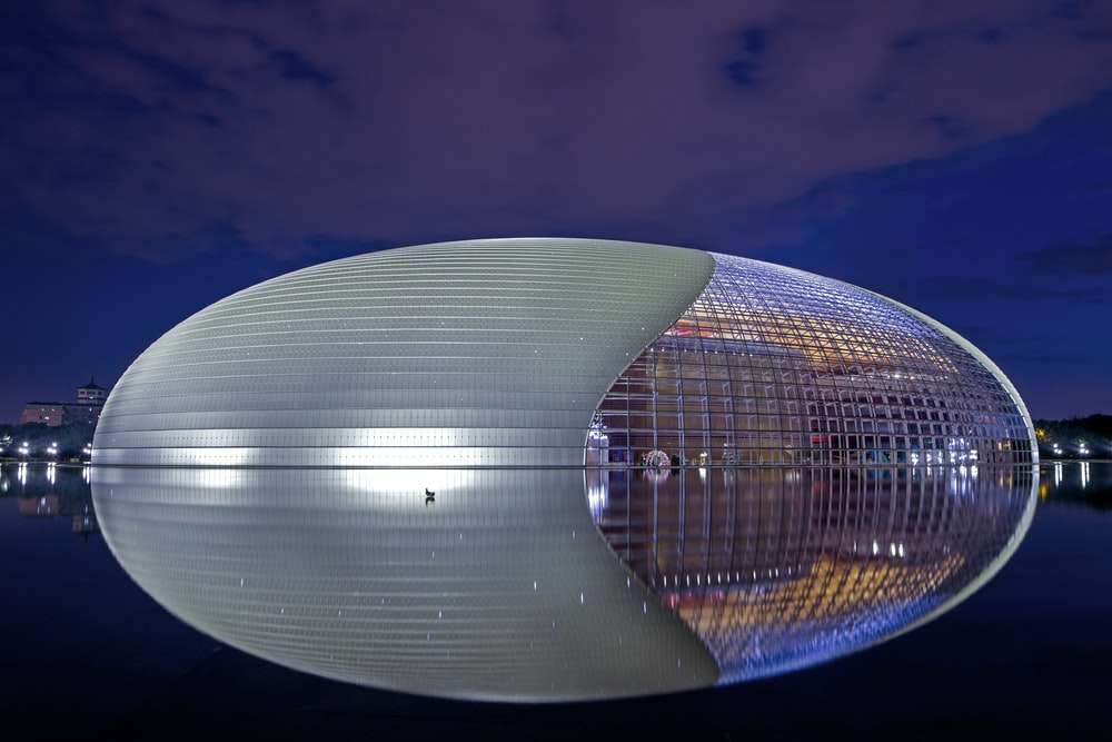 clear glass round building during night time