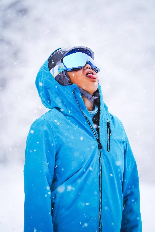 man in blue zip up hoodie wearing black sunglasses