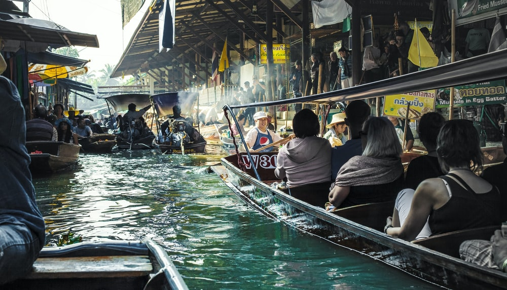 people riding on boat during daytime