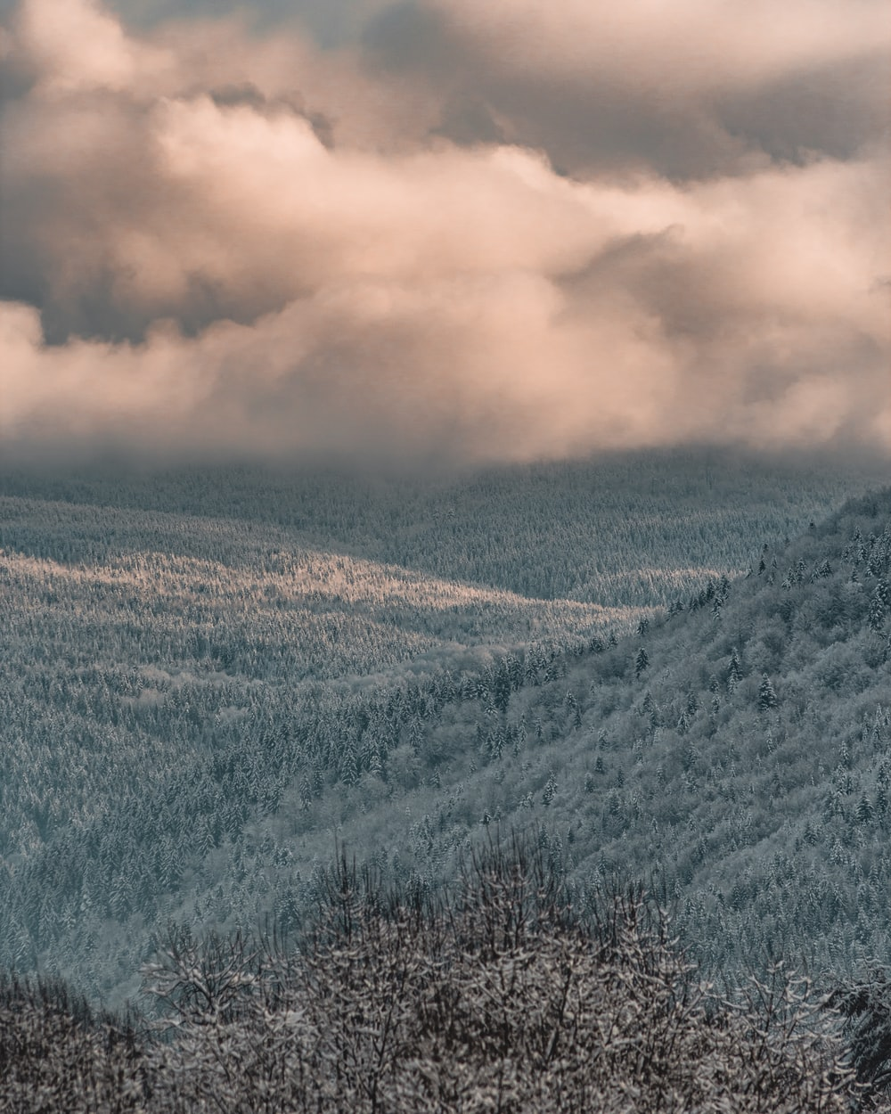 green and brown mountains under white clouds