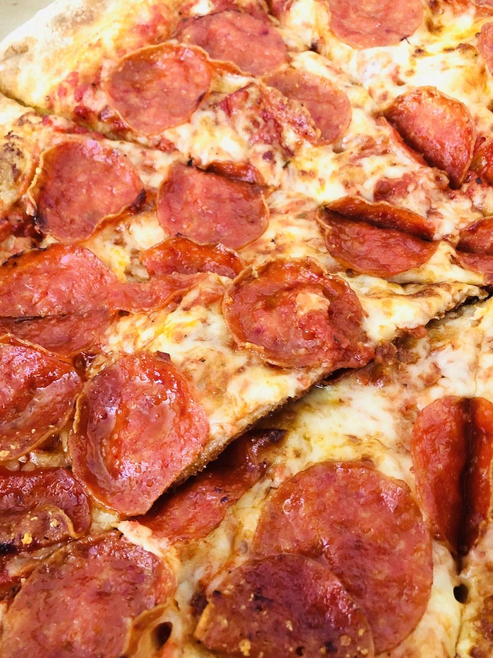pepperoni pizza on white ceramic plate