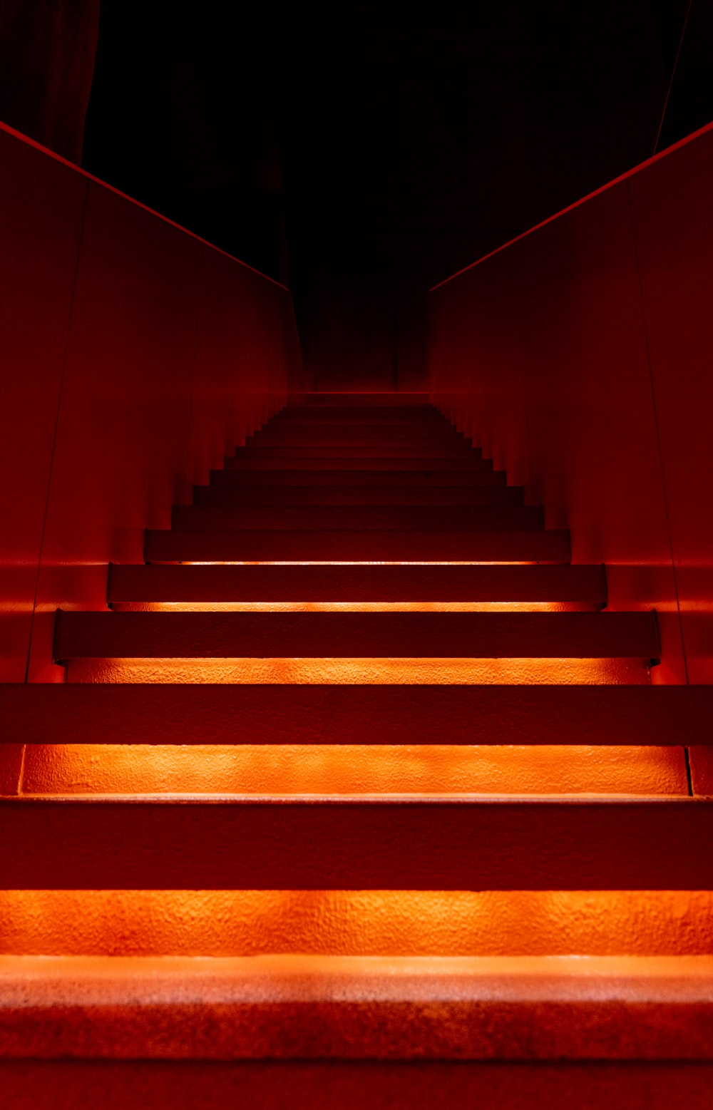 brown and black staircase with yellow and red lights