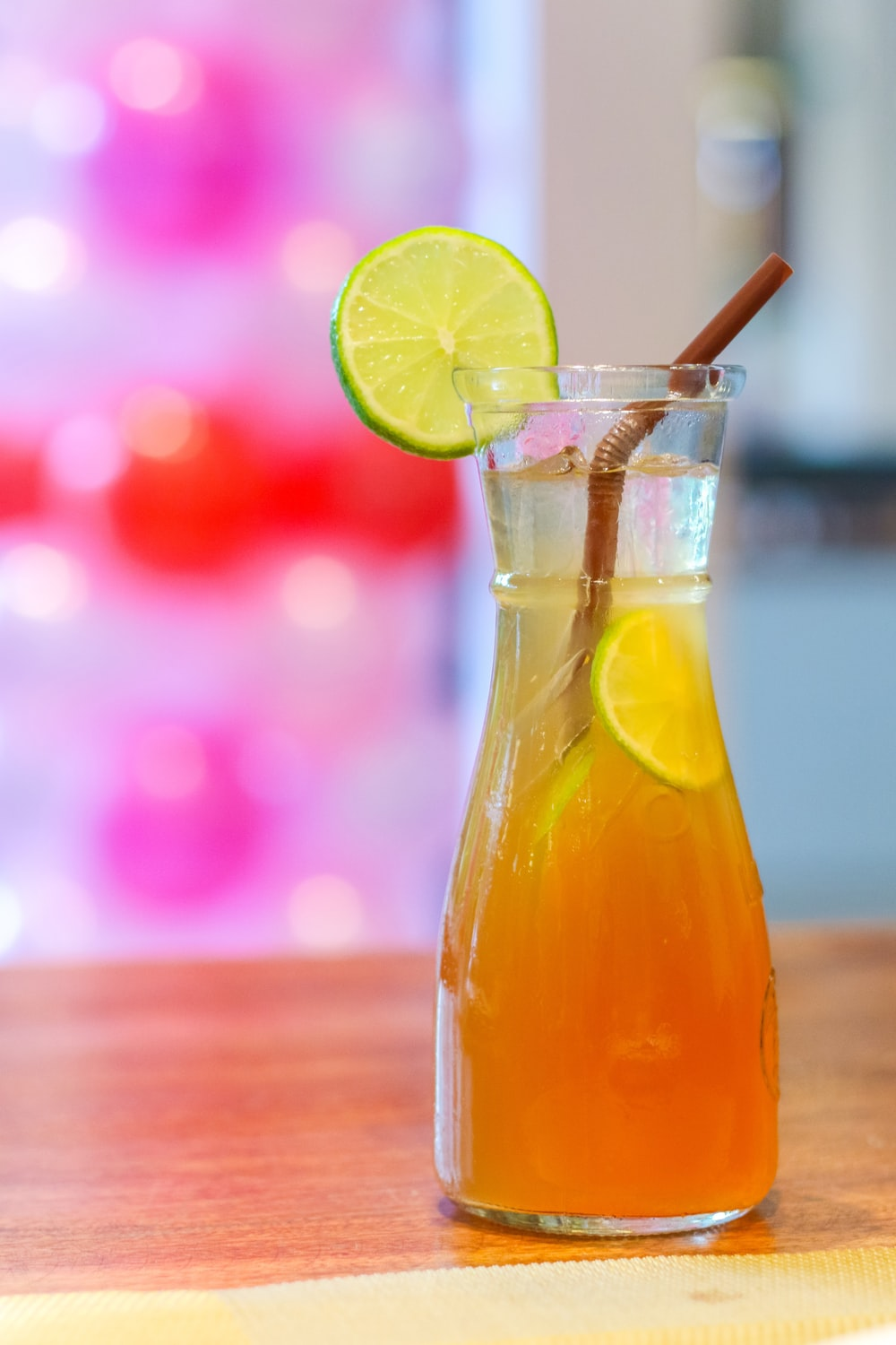 clear glass bottle with yellow liquid and sliced lemon
