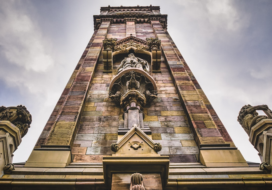 Looking up the Albert Memorial Clock, Belfast's very own leaning tower. The clock memorializes Queen Victoria's Prince Consort, Albert. It is built from sandstone, and like the leaning tower of Pisa, it is sinking which causes it to lean (May, 2020).
