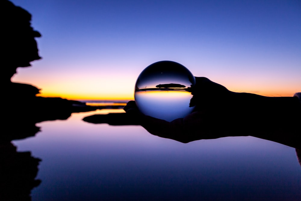 clear glass ball with reflection of sun