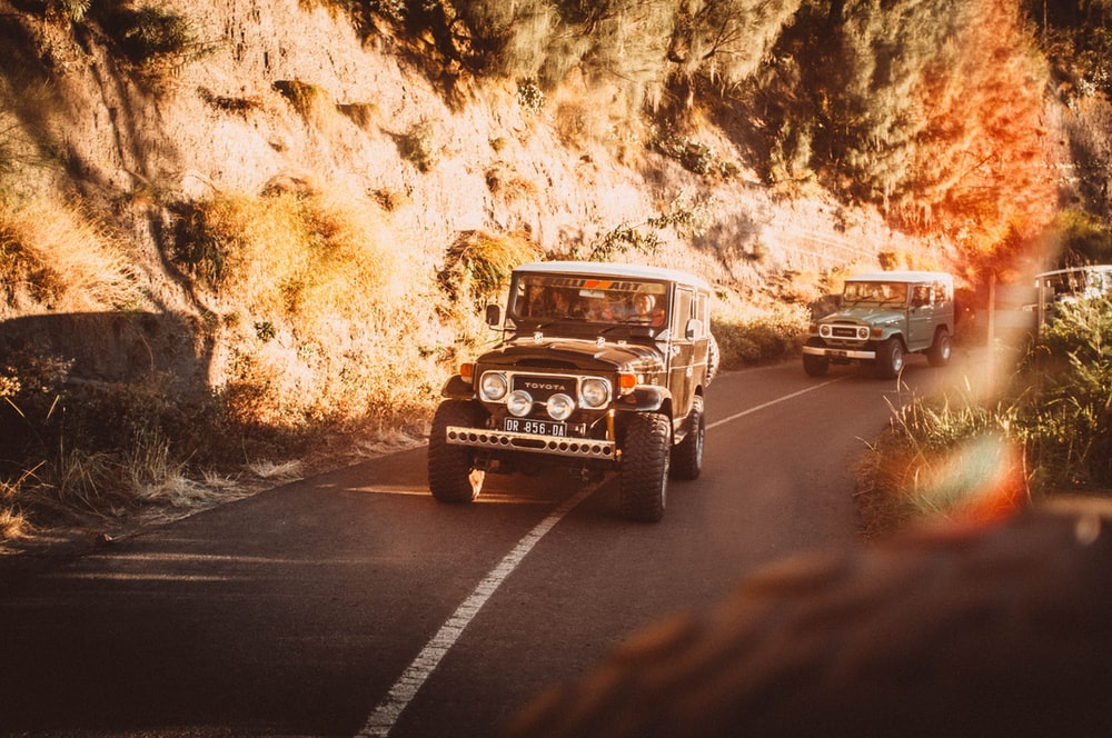 black jeep wrangler on road during daytime