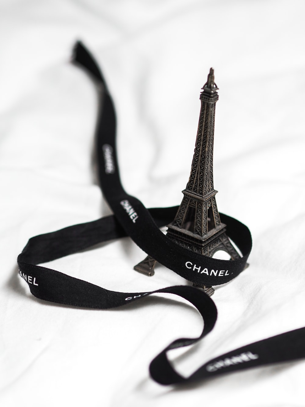eiffel tower scale model on white textile