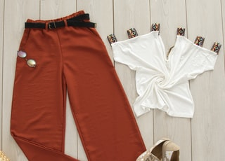 red pants on white wooden surface