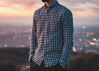 man in blue and white checkered dress shirt wearing black sunglasses