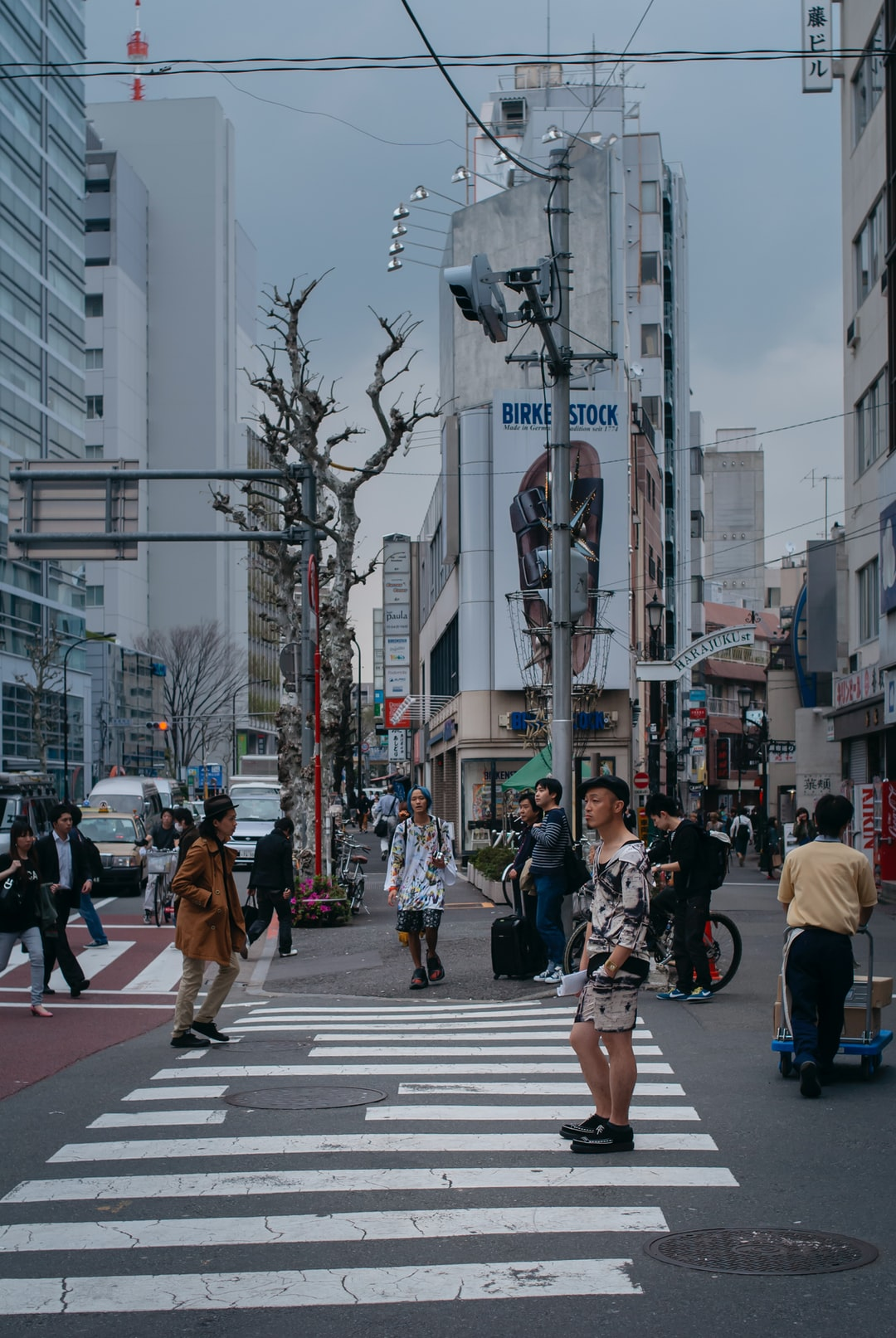 People walking down the street. Shinjuku District, Tokyo, Japan.