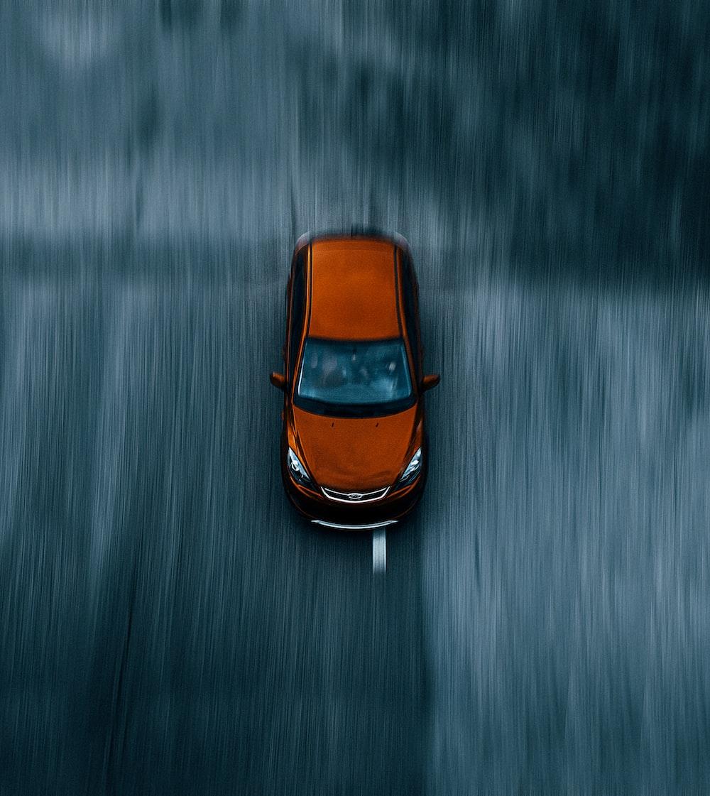 orange and black car on water