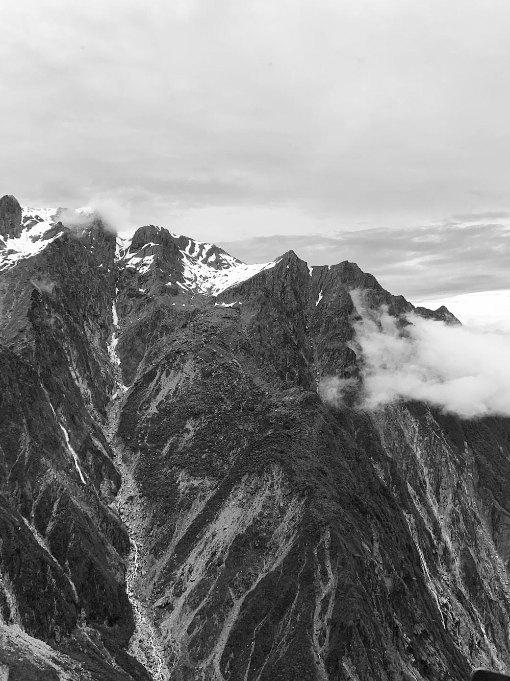 grayscale photo of mountain range