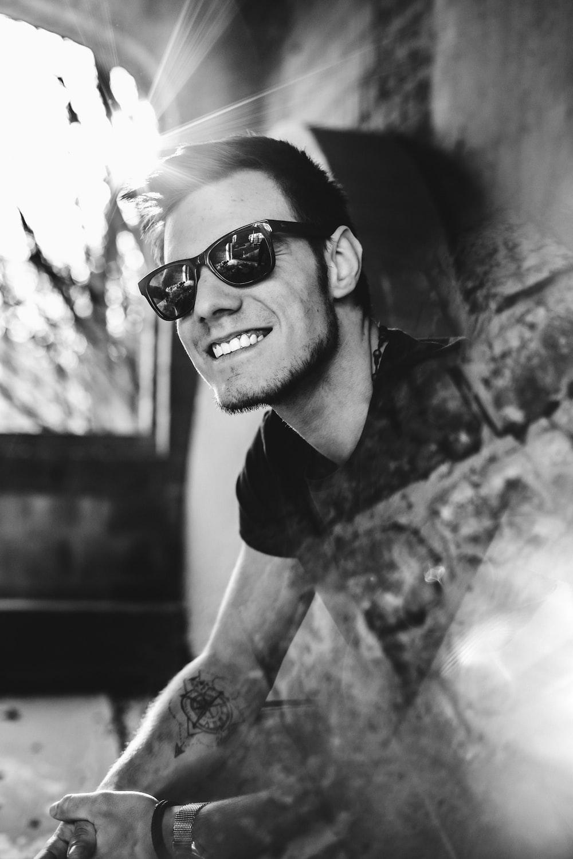 grayscale photo of man wearing sunglasses