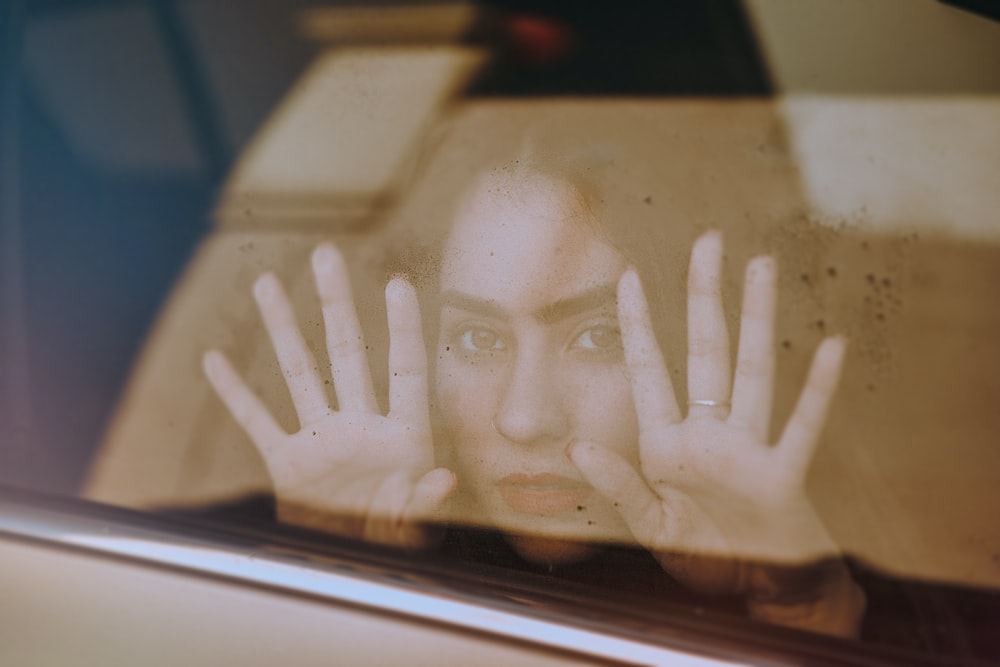 persons hand on car window