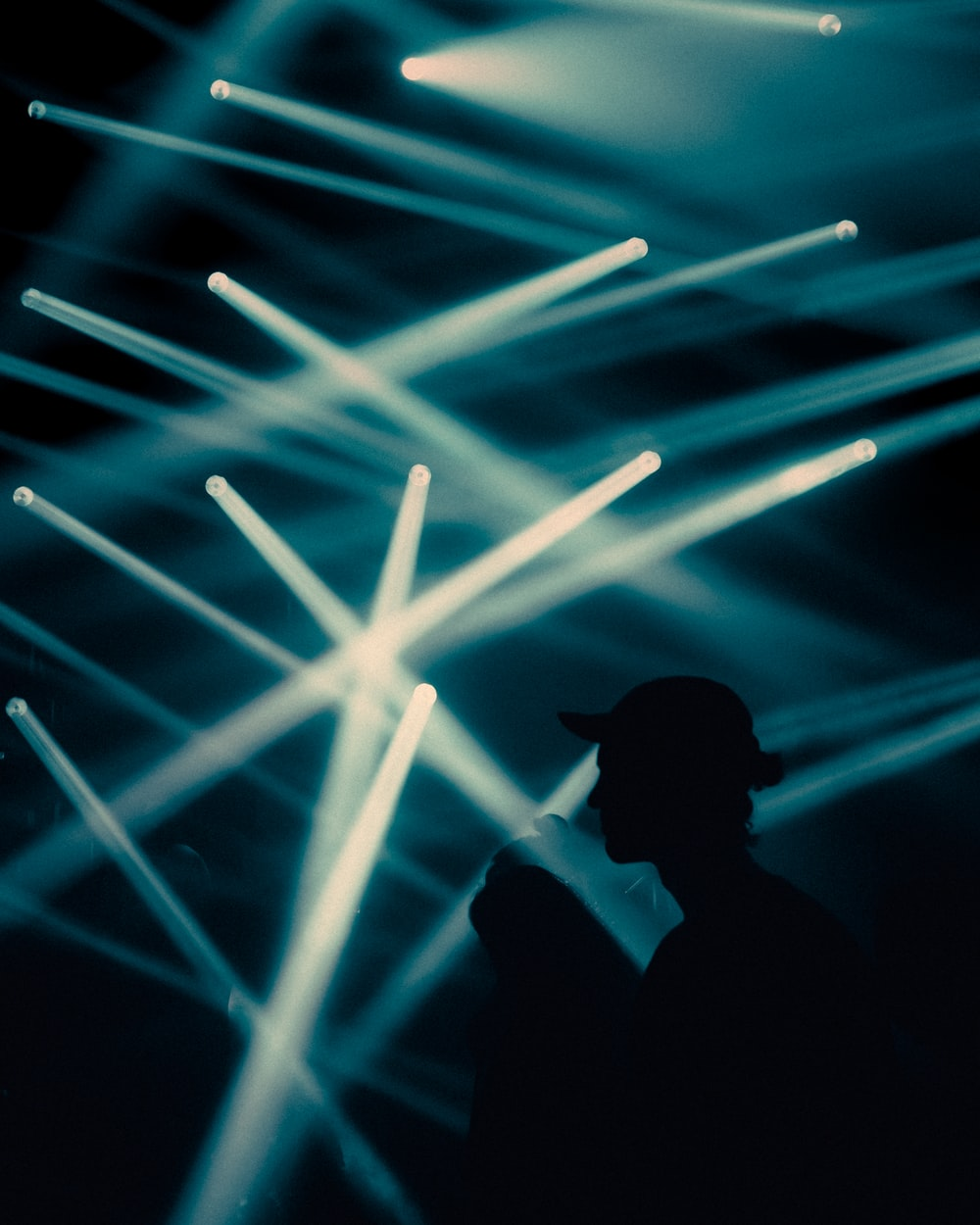 silhouette of man in front of blue light