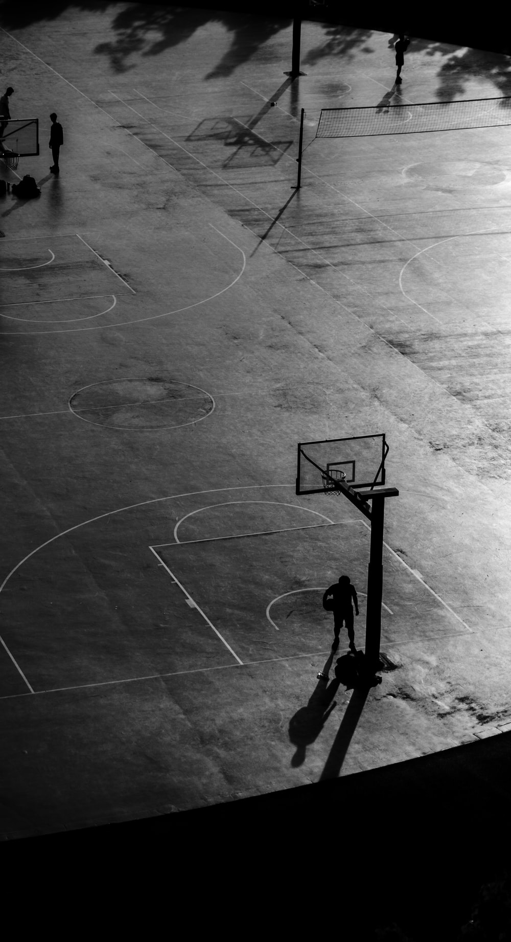 person walking on basketball court