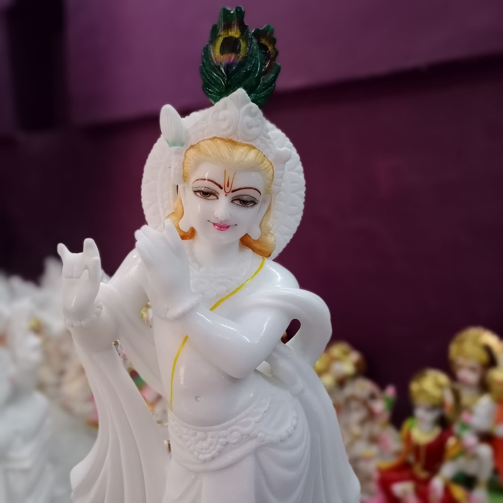 white ceramic angel figurine on table