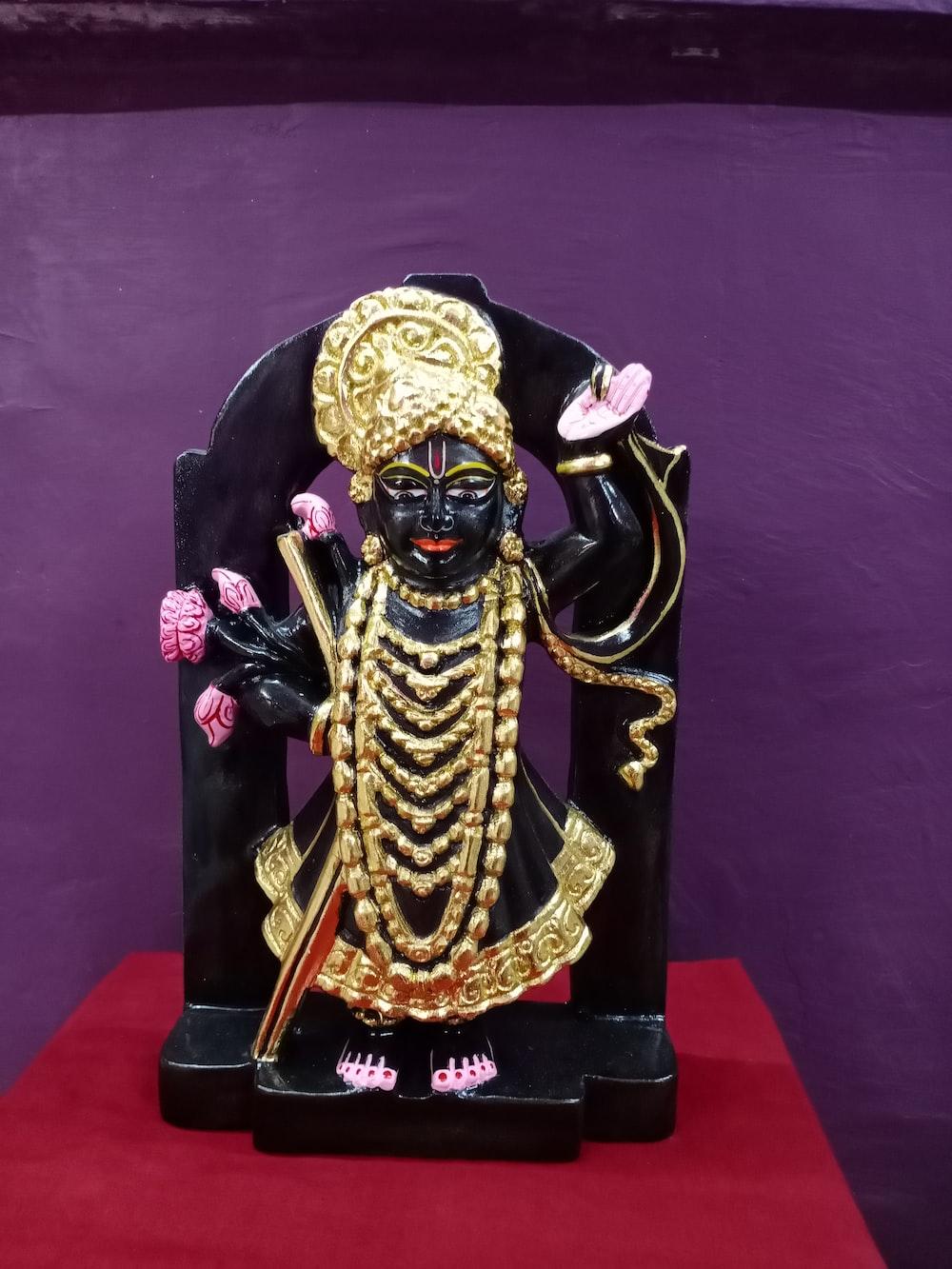 gold and black hindu deity figurine