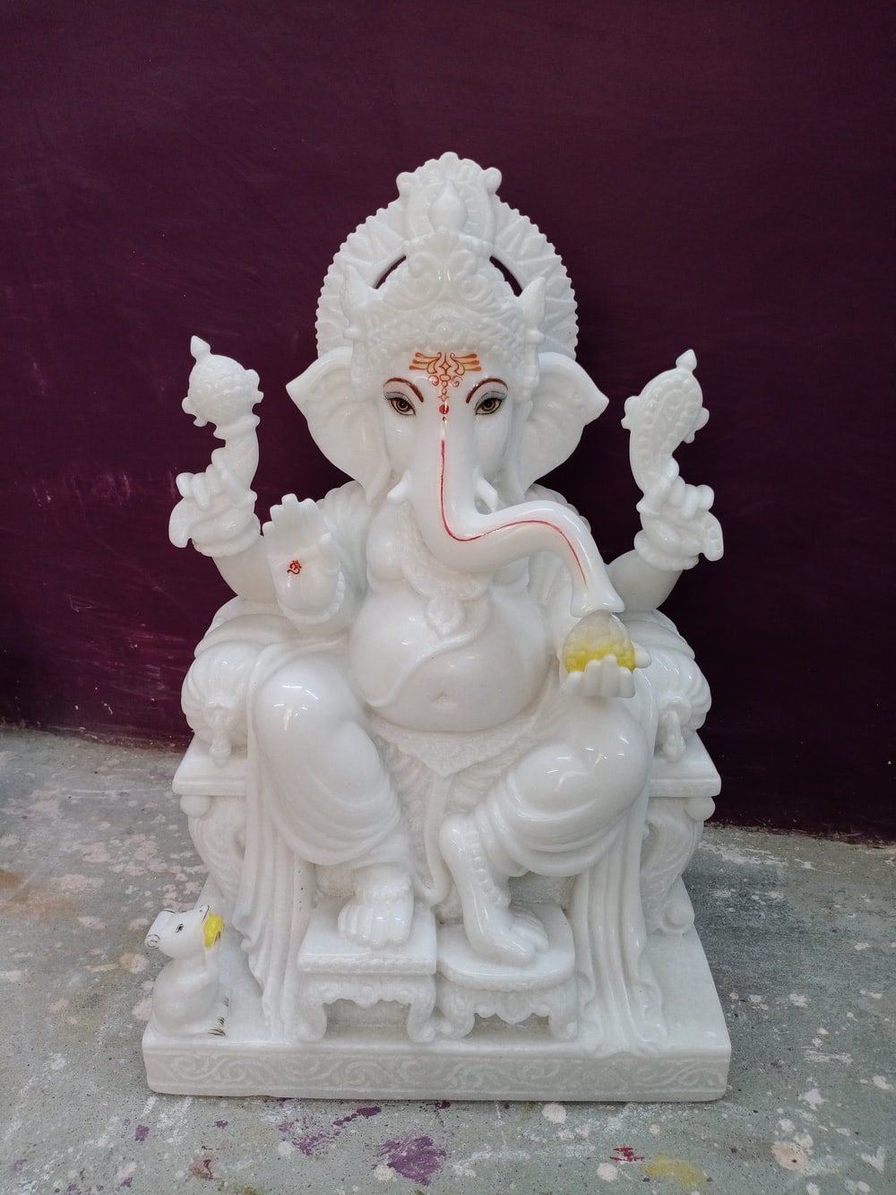 white ceramic figurine on white table