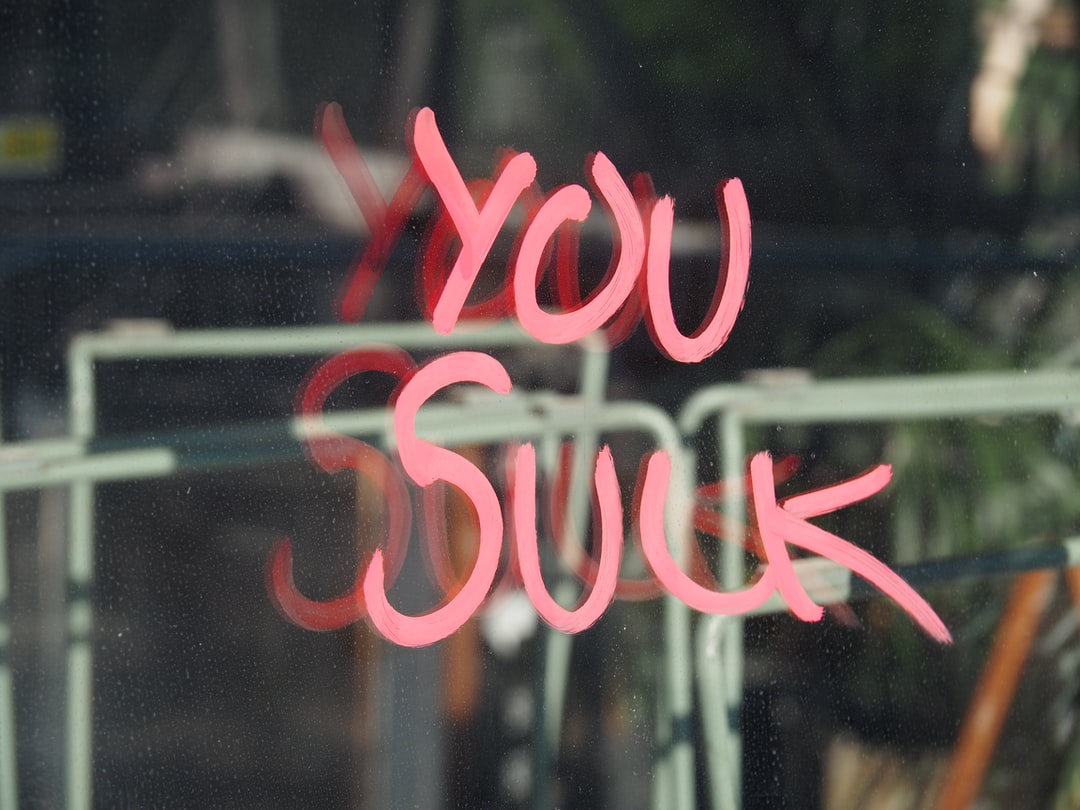 """""""You Suck"""" Glass Reflection."""