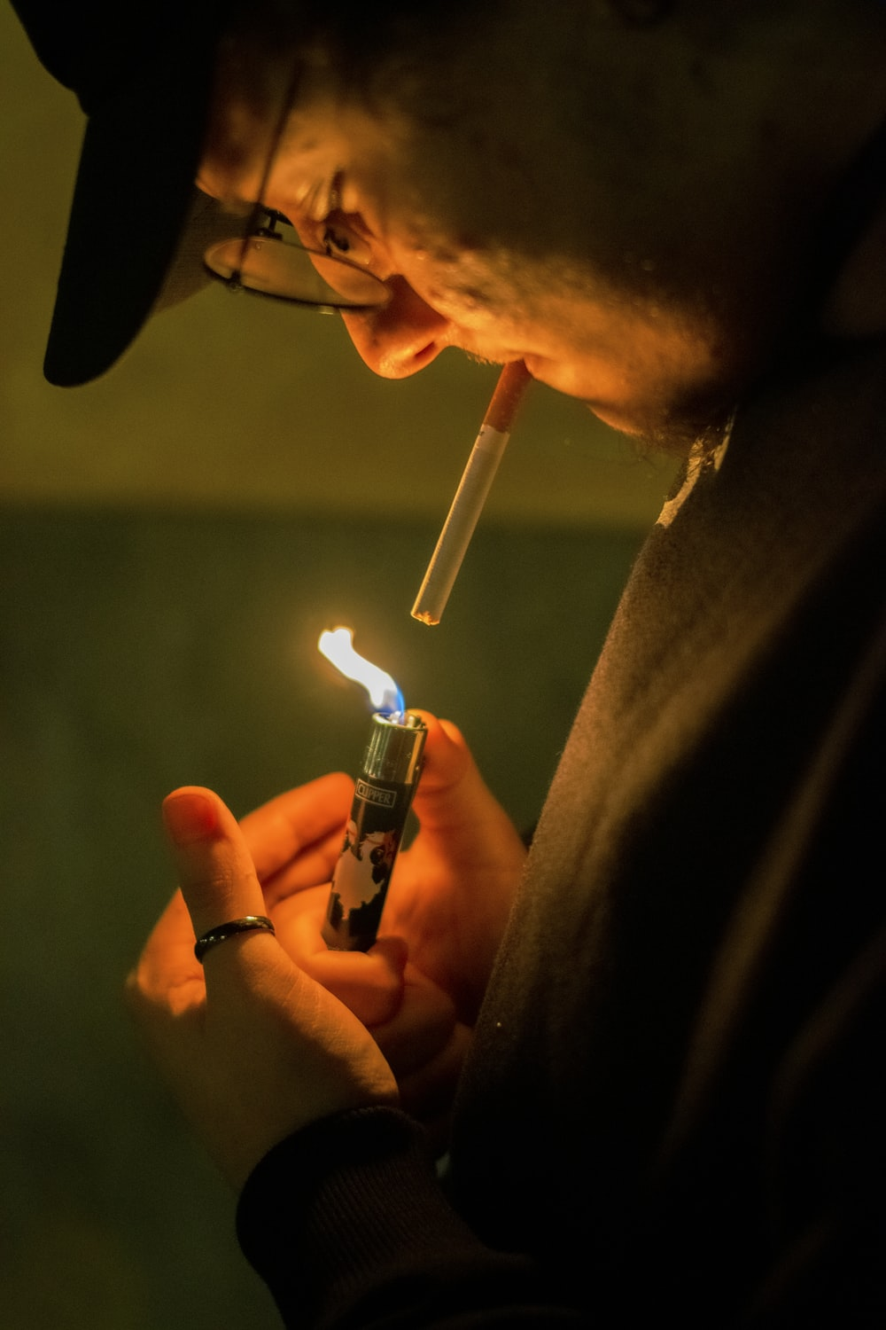 person holding blue disposable lighter