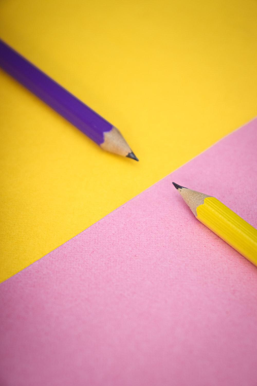 yellow pencil on purple paper