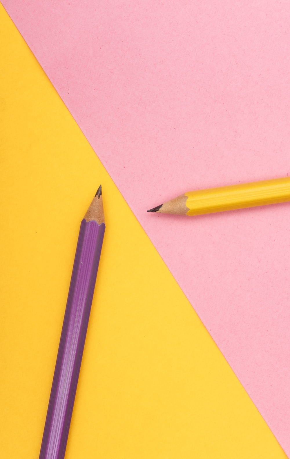 yellow pencil on yellow paper