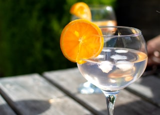 clear wine glass with orange fruit