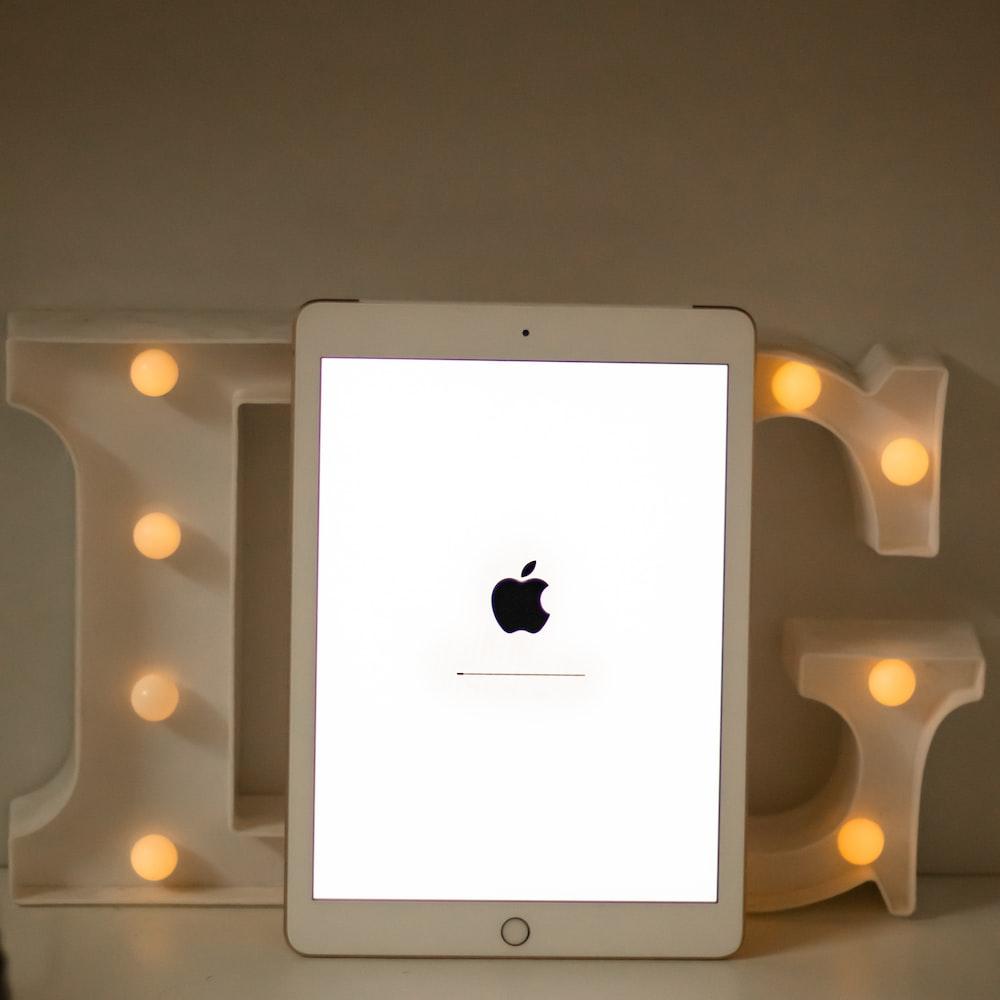 white ipad on white table