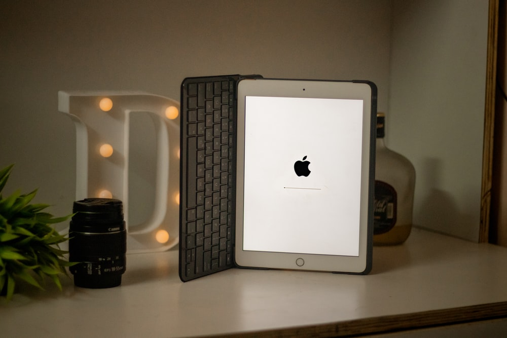 silver ipad on white table