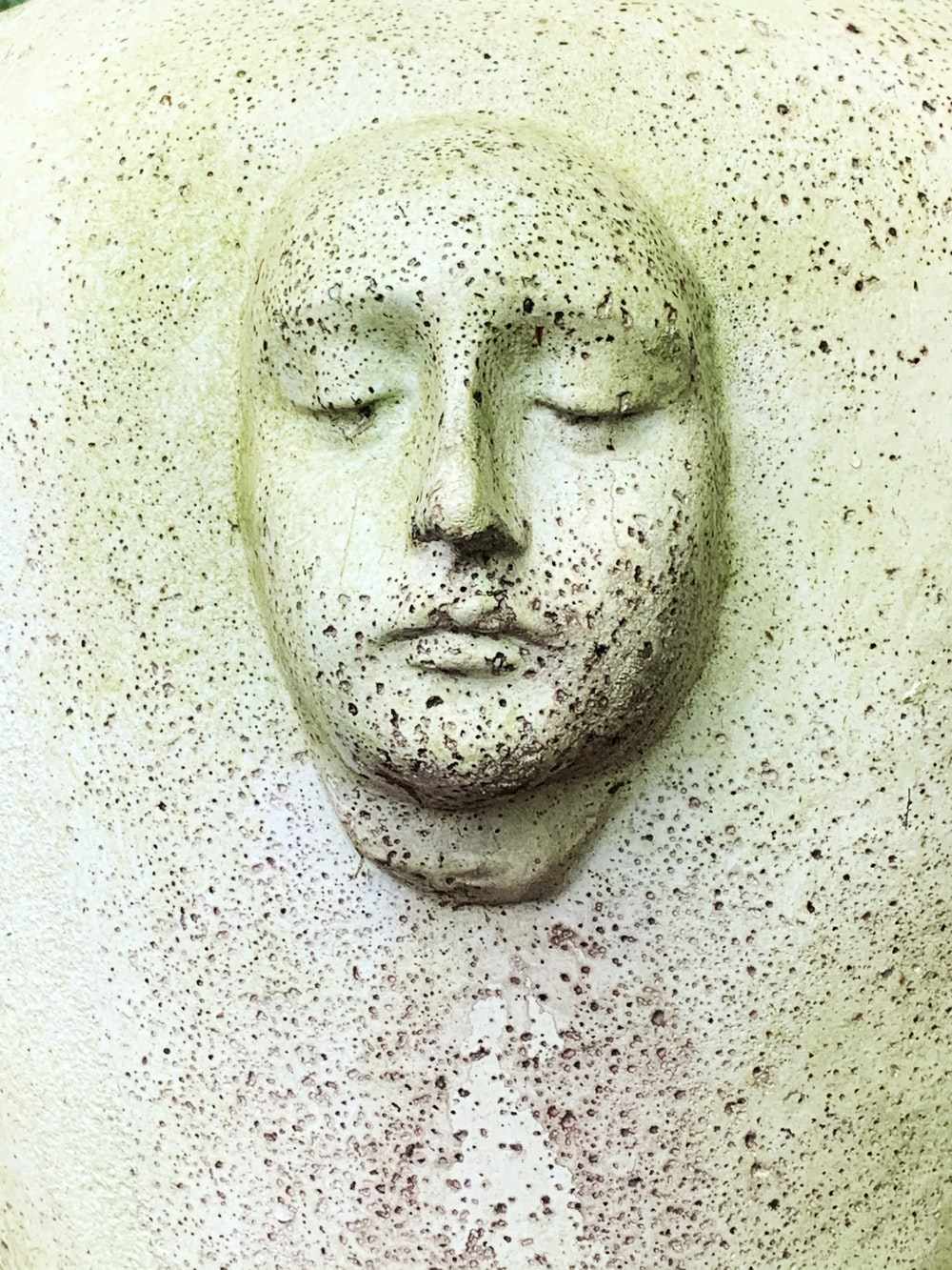 white human face carved on white wall