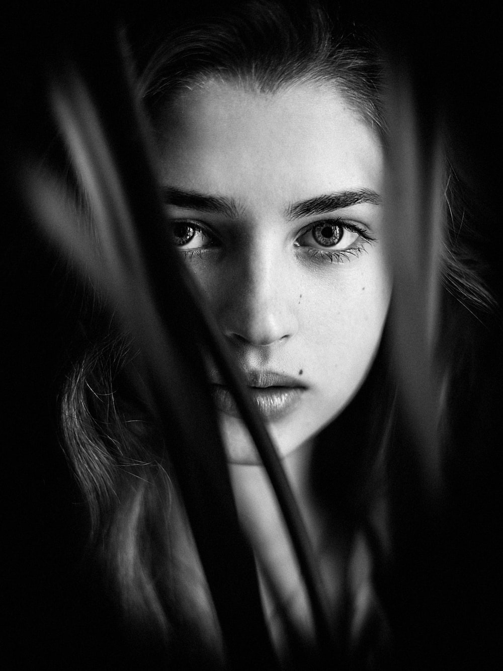 womans face in grayscale photography