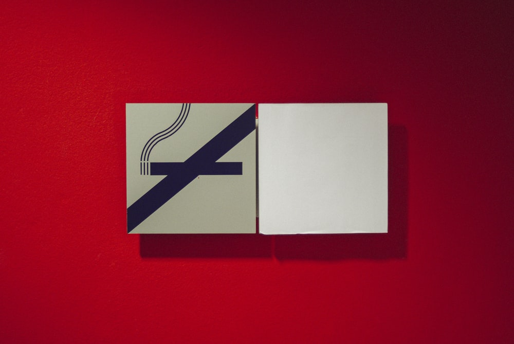 white and red no smoking sign