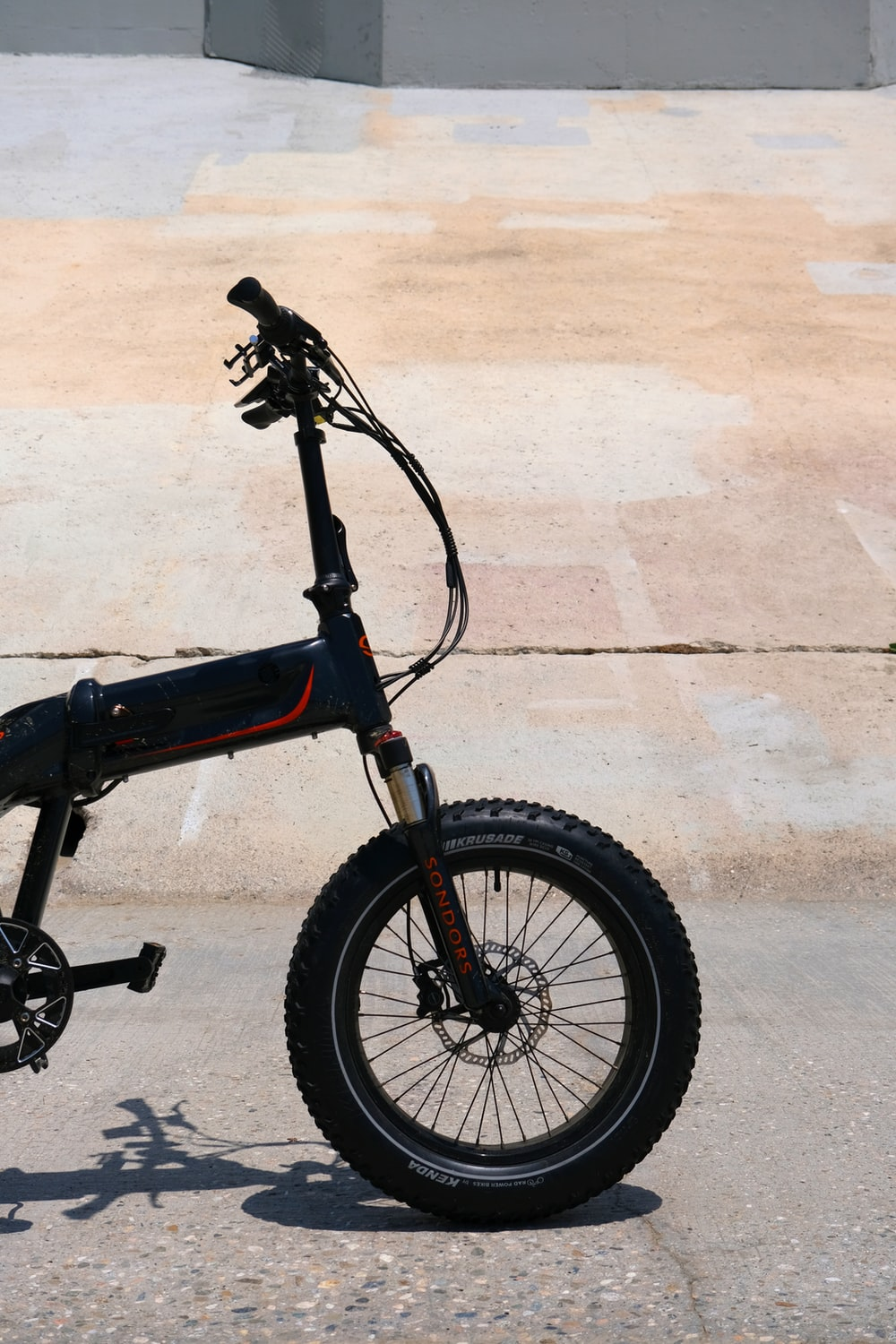 black bmx bike on gray concrete floor