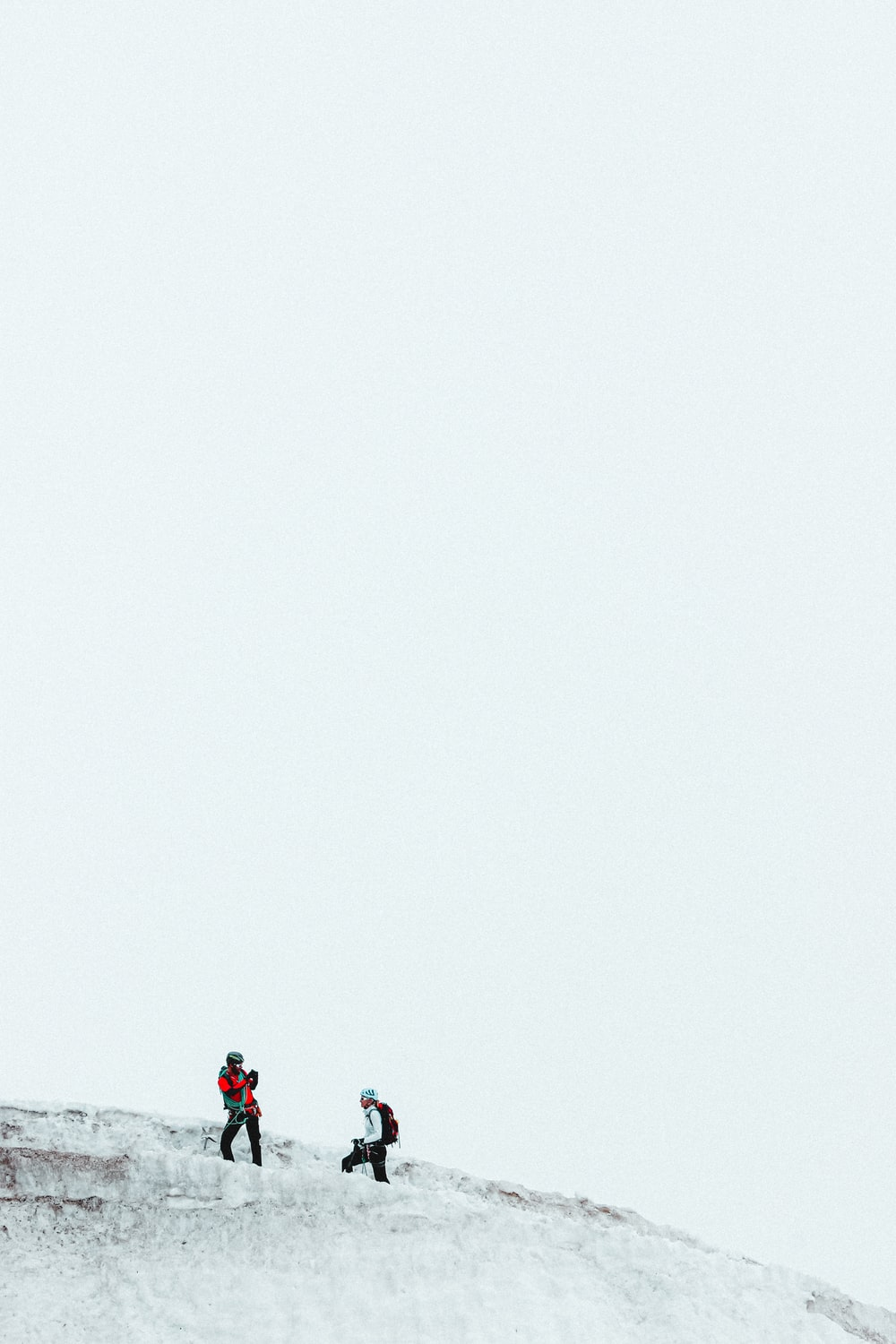 people on snow covered ground under white sky during daytime