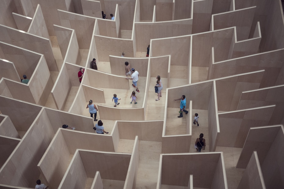 people sitting on white concrete stairs