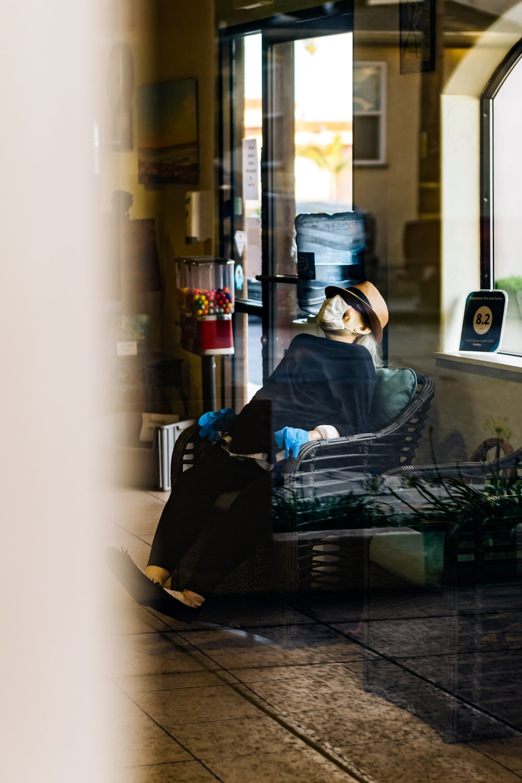 woman in blue hijab sitting on black chair