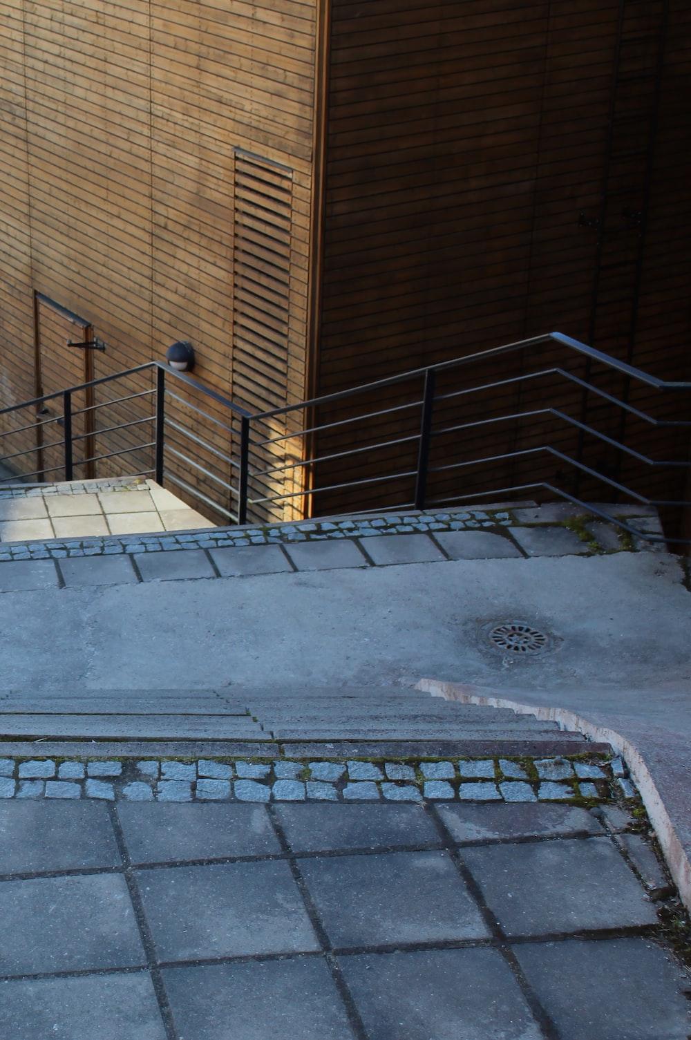gray concrete staircase near brown concrete wall