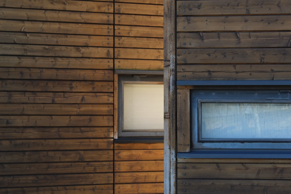brown wooden window frame with white wooden frame