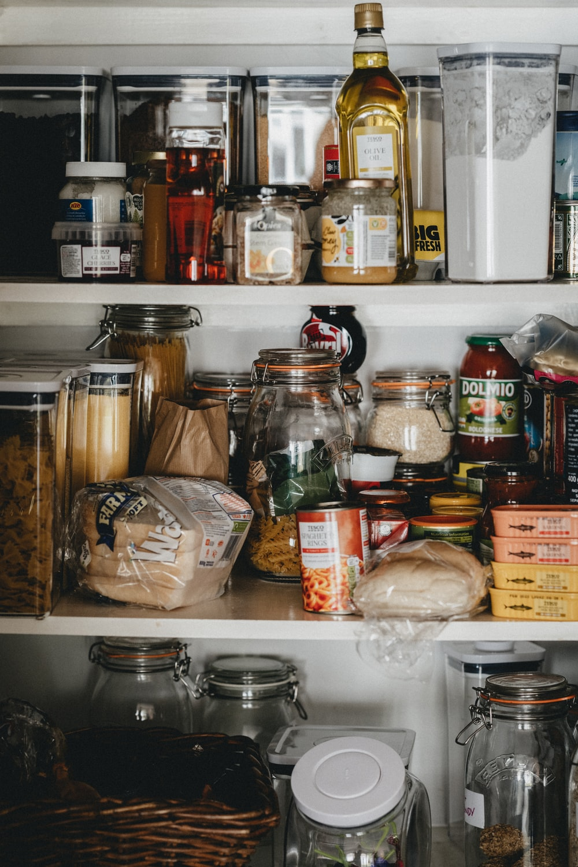clear glass jars on white shelf