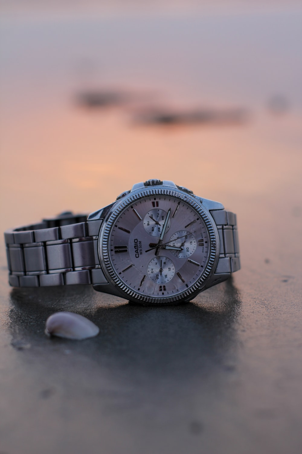 silver link bracelet round chronograph watch