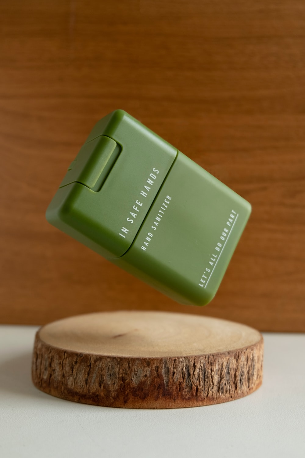 green plastic container on brown wooden round table