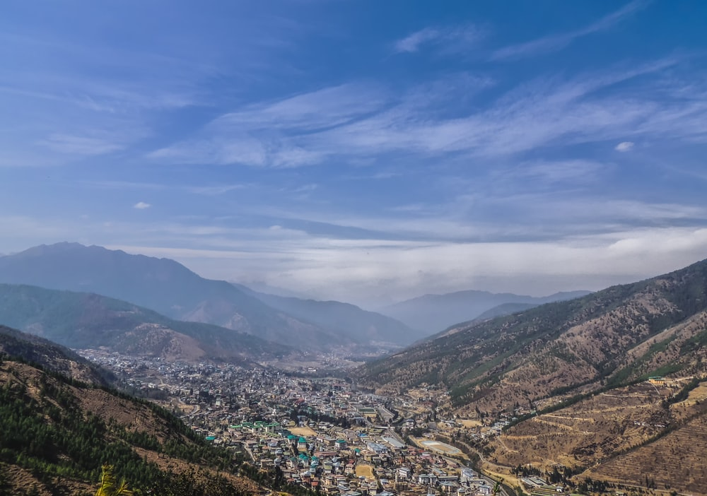 aerial view of city near mountains during daytime