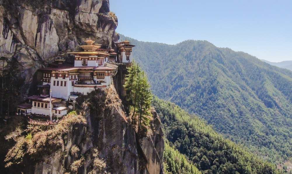 white and brown concrete building on top of mountain during daytime