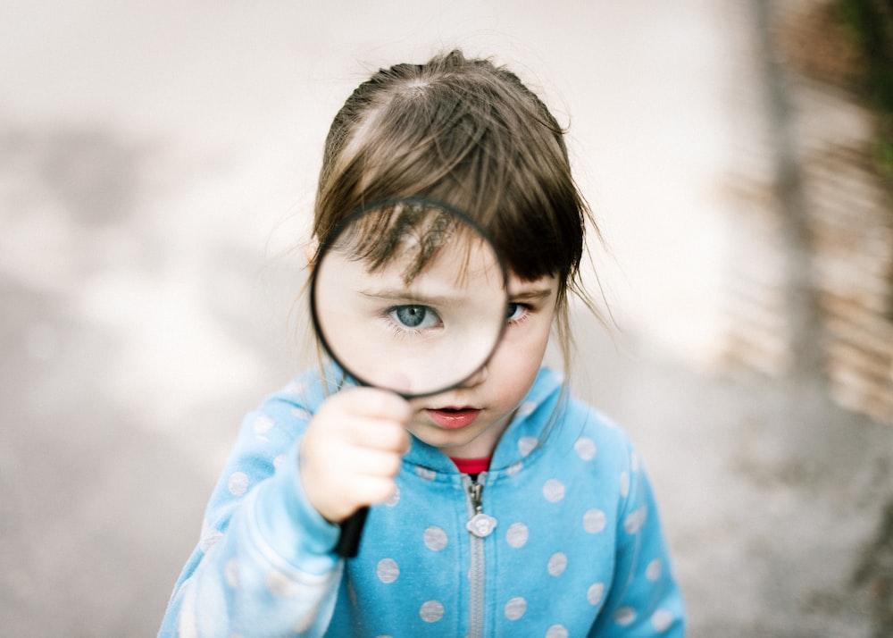 girl in blue and white polka dot jacket