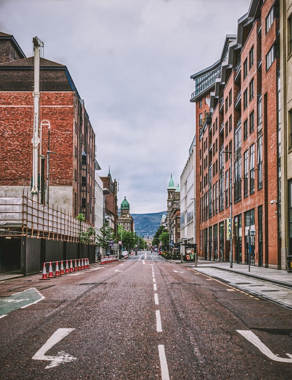 brown brick building beside road
