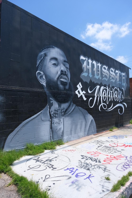 man in gray long sleeve shirt graffiti