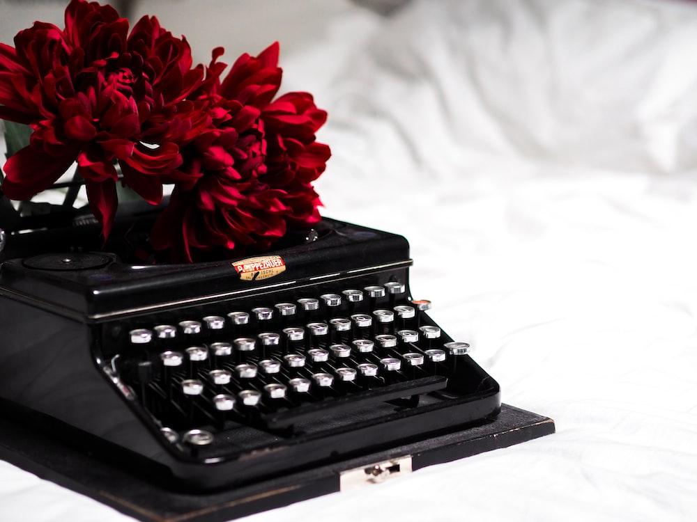 red flower on black typewriter