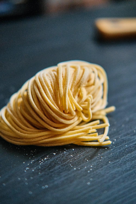yellow pasta on black table